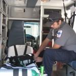 EMS representative prepares