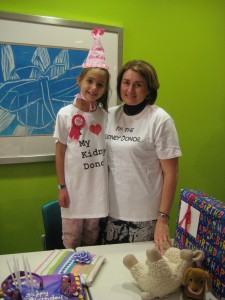 Children's kidney transplant recipient Quinn Roberts, age 8, poses with her donor Cheryl Thomas