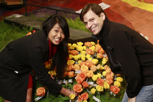 Dr.Shih and her husband Chad Aleman, MD, decorating and dedicating a rose on the actual float prior to the parade.